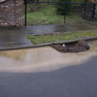 Sediment laden stormwater being contained at a catch basin