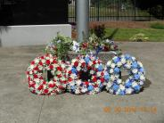Tributes at base of flag